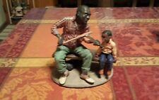 The early American Ebony series fiddler man figure vintage Collectibe
