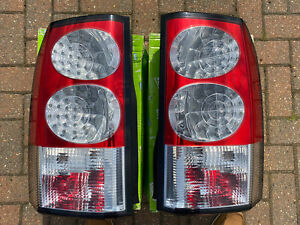 GENUINE VALEO LAND ROVER DISCOVERY 4 PAIR OF REAR LIGHTS.