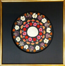 Pressed flower art with Sand dollar center with black circle mat with gold frame