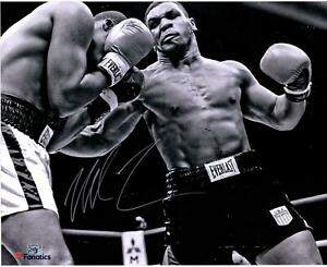 """Mike Tyson Autographed 16"""" x 20"""" Black & White Punching Photograph"""
