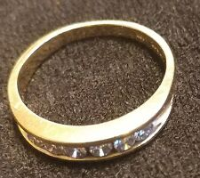 Channeled 14K yellow gold 4 mm diamond ring with .30 Carats in size 9 Pristine