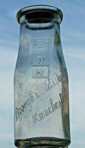 Half-pint wide-necked milk bottle from BROUGH & WILD, MANCHESTER.
