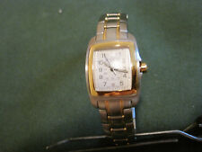 #71  ladys stainless steel  and gold plate SWISS ARMY military date  watch