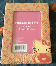 Sanrio Hello Kitty sitting pink 4 by 6 in photo frame w stand. NIP