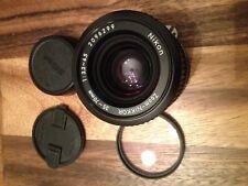 NIKON F PHOTOMIC HEAD,LEATHER CASE,F2 STANDARD LENS,35/70mm NIKKOR ZOOM LENS