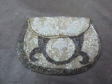 BEAU PORTE-MONNAIE ancien, en sablé de perles de nacre.