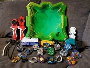 Huge Lot 11 Beyblades Spinning Tops + Arena Launchers Rip Cords Blades & Parts
