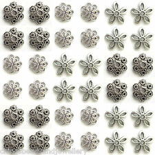 Assortiment de 100 10-15mm tibetan silver bead caps