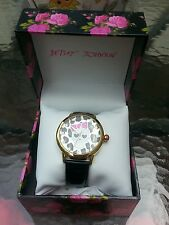 Betsey Johnson black patent leathet Strap Watch with the sull on a face