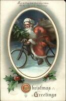Christmas - Santa Claus Riding Bicycle c1910 Postcard - Clapsaddle?