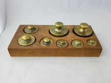 Vintage wooden box of brass scale weights