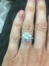 sterling silver 10 mm round brilliant Moissanite ring. Size 4