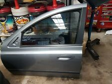 FORD BA  FALCON  LEFT HAND FRONT PASSENGER DOOR SHELL PAINT CODE: M7 SILVER