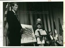 Press Photo Jayme Buck with Flagson Parade Stamp - sya29764