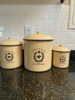 enamel canisters cream color with black trim. French design. Small med and large