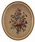 A Framed Oval Tapestry with Bouquet of Flowers