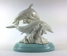 Realistic Dolphins Jumping in Ocean Waves Sculpture
