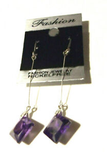 White gold filled drop earrings suspended in air with purple Amethyst