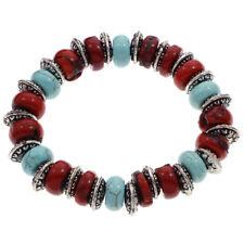 Pulsera de coral rojo, bolas de turquesa y discos de plata tibetana