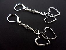 A PAIR OF DANGLY TIBETAN SILVER  TWO  HEARTS  LEVERBACK HOOK EARRINGS.  NEW.