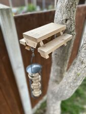 wooden bird feeder bench