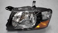 Headlights LHS Black Backed suit Mitsubishi Pajero NM / NP - Brand New Genuine -