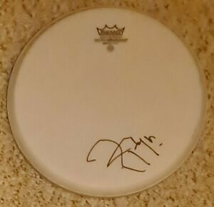"""Roger Taylor 'Queen' hand signed in person Remo 10"""" white drum skin."""