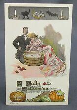 Antique Halloween Postcard Lounsbury Couple Bobbing for Apples Vegetable Border