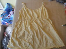 Yellow top with white polka dots size 10-12 by evie