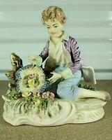 "Antique Arnart Porcelain Figurine, Boy with Flowers, 7"" H."