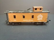"HO CANDIAN NATIONAL 74003 ""SERVE ALL CANADA"" ORANGE CABOOSE"