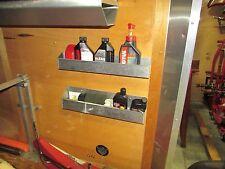 Pit pal alum trailer fluids storage rack for inside trailer wall or on the door.