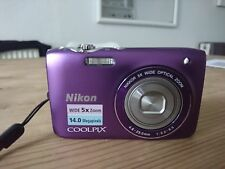 Purple Nikon coolpix S3100 camera