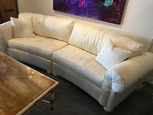 Pair of custom silk demi lune sofas