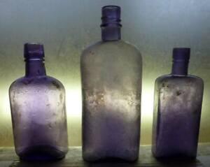 SUNROOM DECORATOR BOTTLES-Three Assorted Whiskey Flasks-Dark Amethyst-1890s-1910