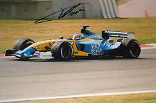Fernando Alonso firmado 12x8, F1 Renault RS23. prueba de pre-temporada Barcelona 2003
