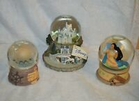 Two Walt Disney Snow Globes_DIsney Castle, Pocahontas and Santa World Snow Globe