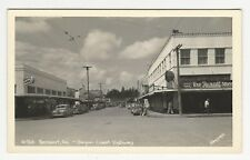 RPPC, view of business street, Rexall drug store, Reedsport, Oregon, ca1950s