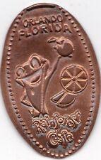 Elongated Souvenir Penny:Rainforest Cafe Orlando Florida(Frog with orange) Z 96A