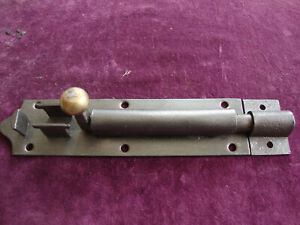 Antique iron and brass 1880 security door bolt with keep