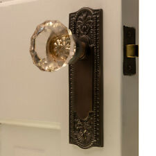 The Orlean Passage Set in Bronze Finish with Glass Door Knobs