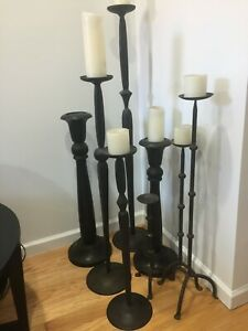 Collection of 8 Floor Standing Candle Holders, 2 Wood, 6 Iron, Various Sizes