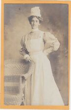 Studio Real Photo Postcard RPPC - Nurse Next to Rattan Chair