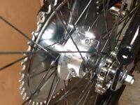 66cc 80cc MOTORIZED BIKE REAR HUB SPROCKET MOUNT.USE STOCK NINE HOLE SPROCKET