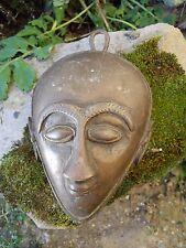 1 / Masque en bronze tète de personnage ethnique
