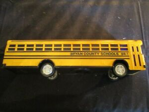 BLUE BIRD TOY SCHOOL BUS WITH COIN STOPPER