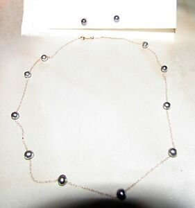 14 karat yellow gold and black pearl necklace with matching earrings