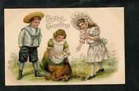 A249 Antique Postcard  Easter children with hen and chicks and colored eggs 1907