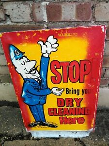 VINTAGE DRY CLEANING SIGN WITH POLICEMAN DESIGN. DOUBLE SIDED 18 INS  x 25 INCH