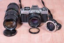 Minolta XG-1 con 50mm 1.7 + Soligor 90-230 + duplicador de focal